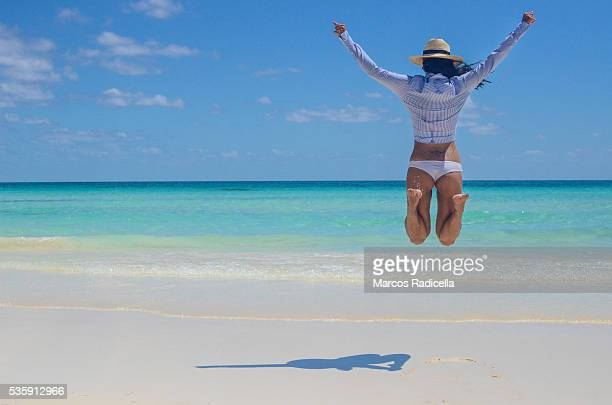 jumping in the beach, cayo coco, cuba. - radicella stock photos and pictures