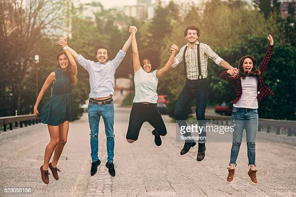 jumping in the city - five people stock pictures, royalty-free photos & images
