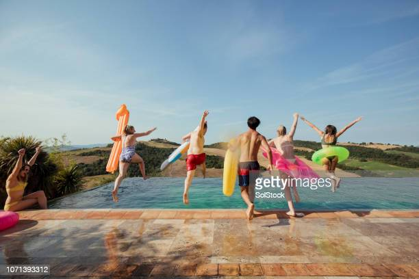 jumping in the pool - pool party stock pictures, royalty-free photos & images