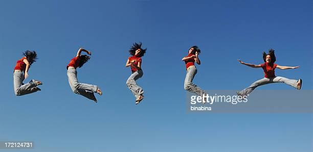 jumping in the sky - positioning stock pictures, royalty-free photos & images