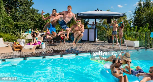 jumping in to summer - pool party stock pictures, royalty-free photos & images