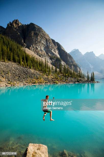 Jumping into a cold mountain lake