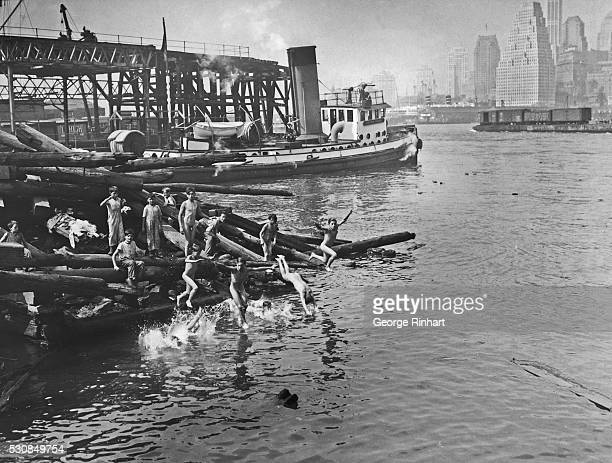 Jumping into the old swimming hole at the foot of Pierpont Street in Brooklyn New York What do these kids care if the waters of the East River are...
