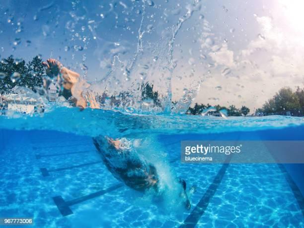 jumping into the swimming pool - piscina pubblica all'aperto foto e immagini stock