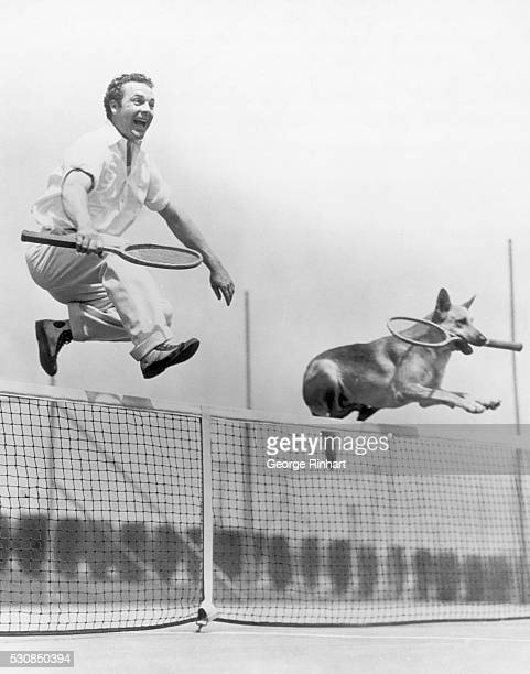 Jumping Jehosophat] James Murray and canine companion a very mixed doubles make tennis more strenuous James Murray and his doubles partner Flash...