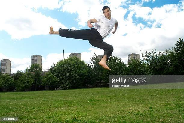 jumping kick in park