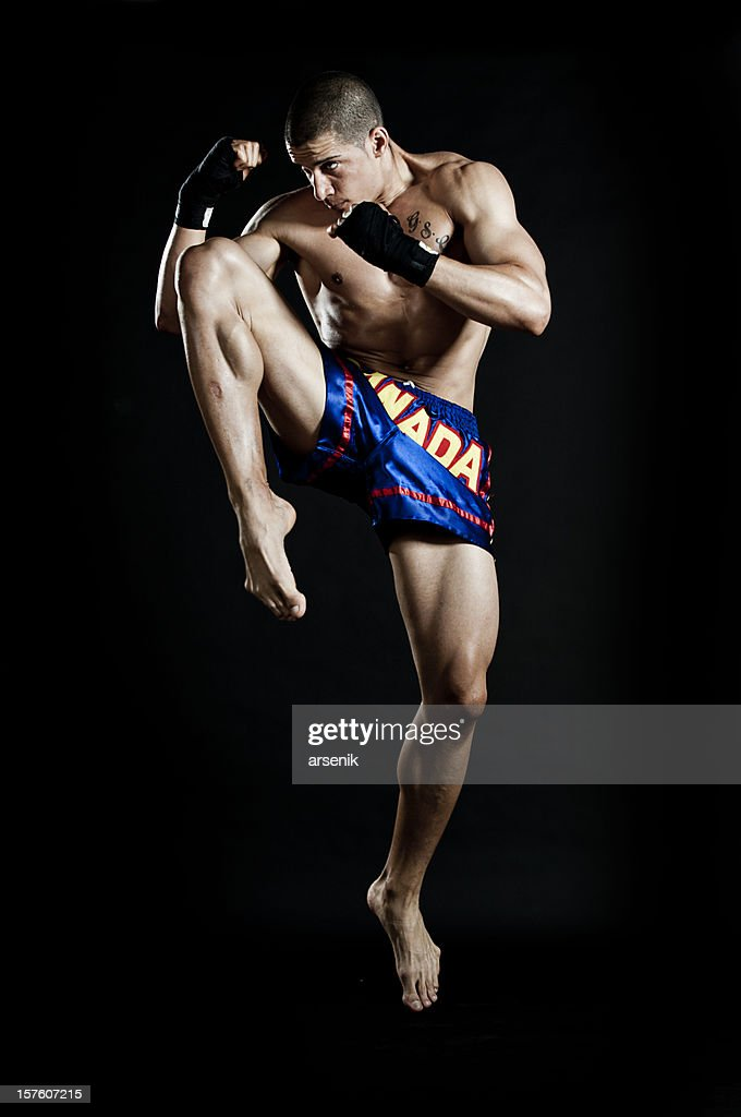 Jumping knee kick : Stock Photo
