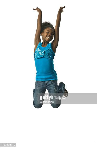 jumping little girl - native african girls stock photos and pictures
