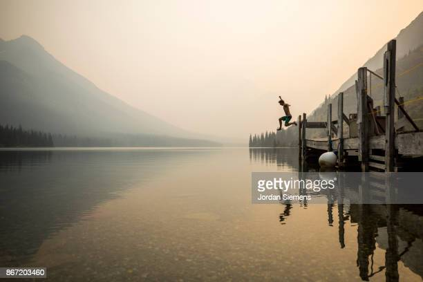 jumping off a dock - mid air stock pictures, royalty-free photos & images