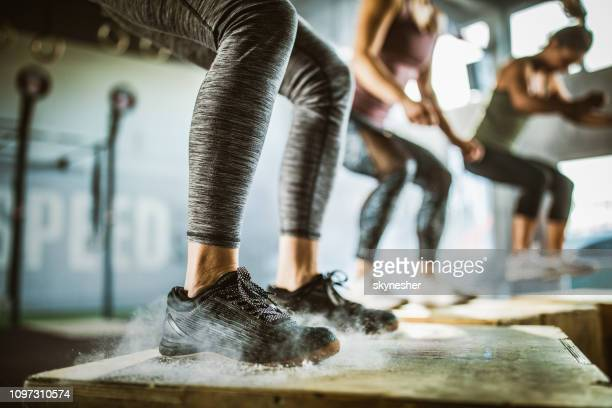 jumping on crate during sport training! - crossfit stock pictures, royalty-free photos & images
