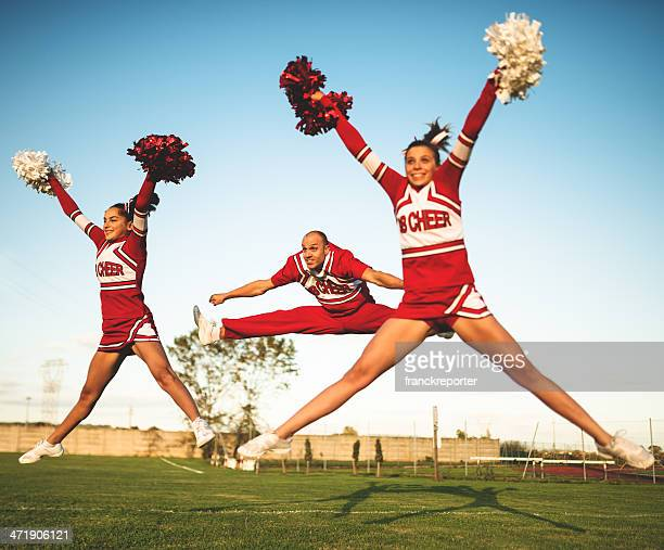 jumping on mid air - cheerleaders team with pon-pon - teen cheerleader stock photos and pictures