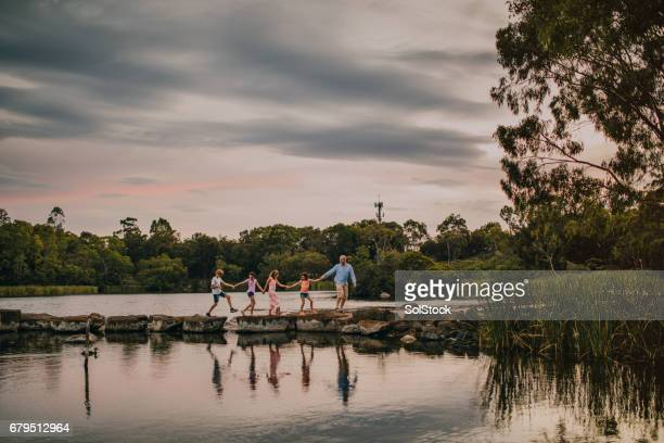 jumping on the stepping stones - victoria australia stock pictures, royalty-free photos & images