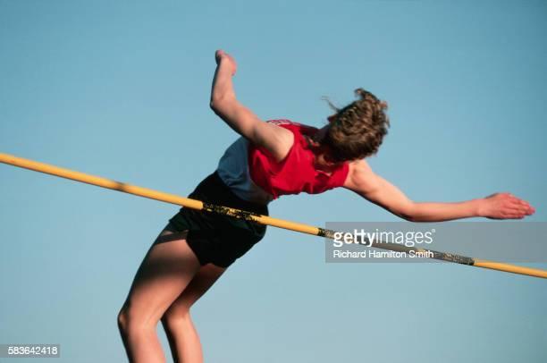 Jumping Over High Jump Bar