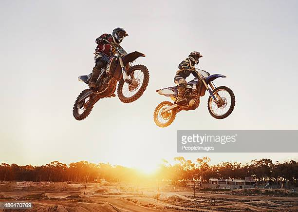 jumping over the sunset - motorsport stock pictures, royalty-free photos & images