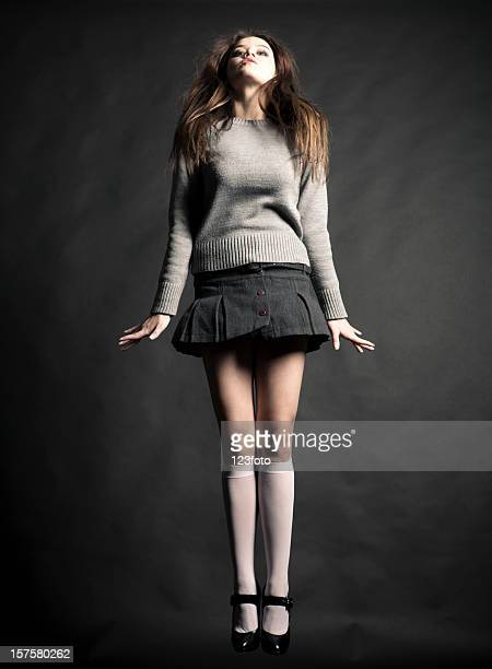 jumping - teen mini skirt stock photos and pictures