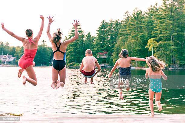 jumping - pier stock pictures, royalty-free photos & images