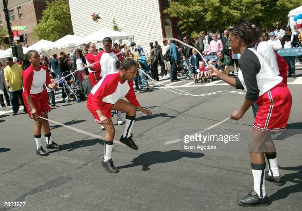 Jumping rope double dutch style at the Tribeca Family Festival Street Fair presented by American Express on Greenwich Street in New York City May 11...