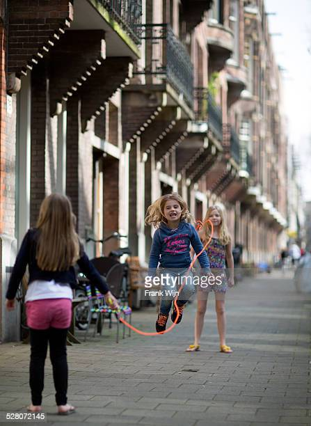 jumping rope in amsterdam - skipping along stock pictures, royalty-free photos & images