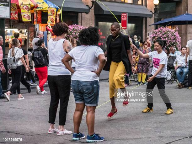 jumping rope in herald square - panyik-dale stock photos and pictures