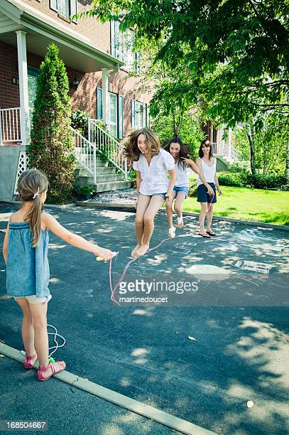Jumping rope in the driveway.