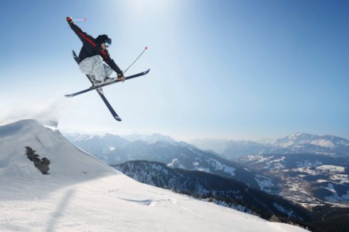 Jumping skier on a snowy mountain 96653419
