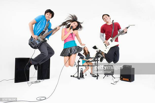 Jumping teenagers in rock band