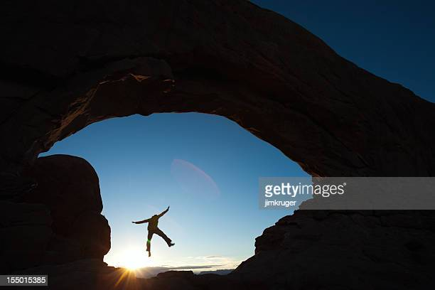 jumping through south window arch. - leap of faith stock photos and pictures