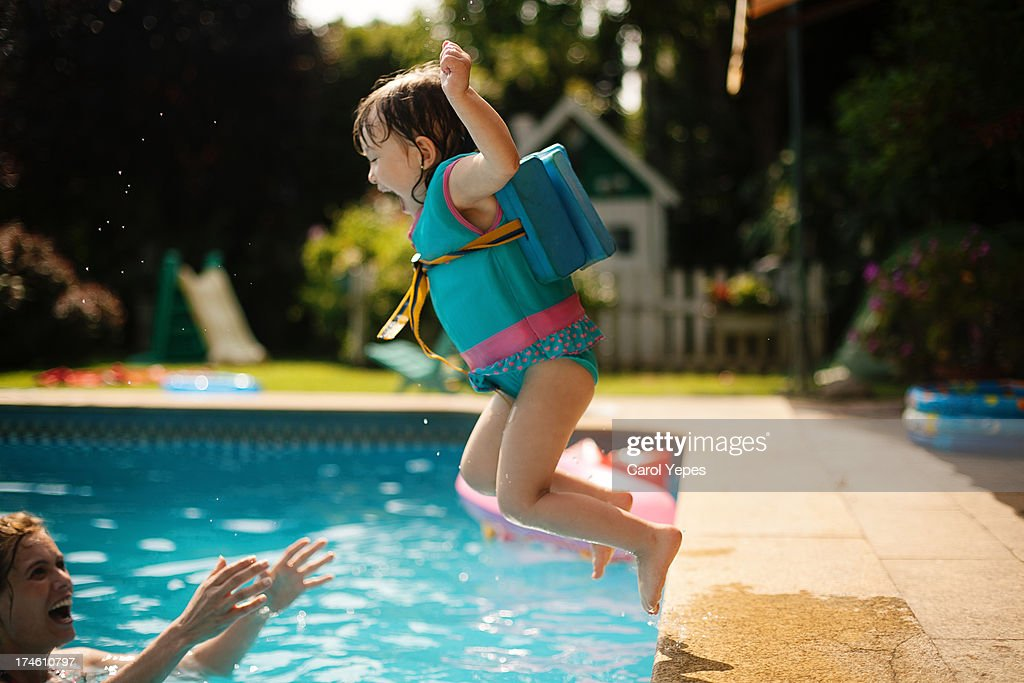 jumping to the pool : Stock Photo