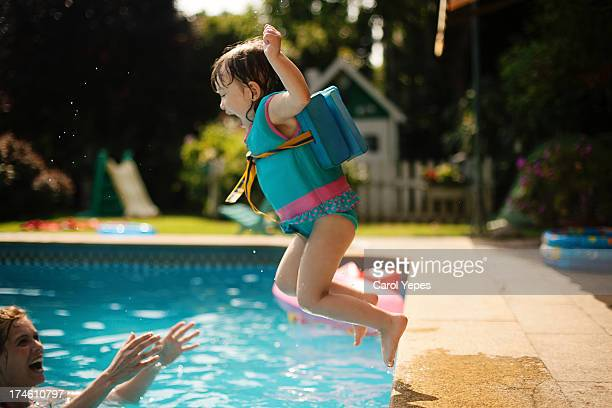jumping to the pool - standing water stock pictures, royalty-free photos & images