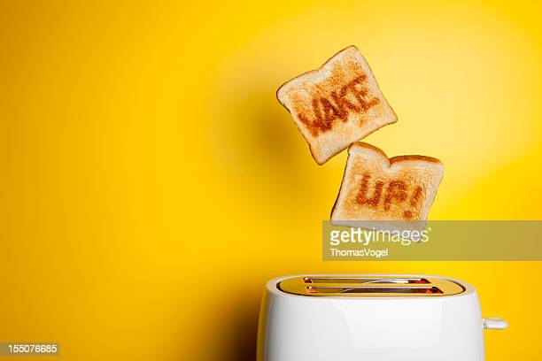 jumping toast bread - wake up! - waking up stock pictures, royalty-free photos & images