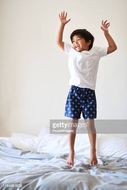 jumping up for joy! - one boy only stock pictures, royalty-free photos & images