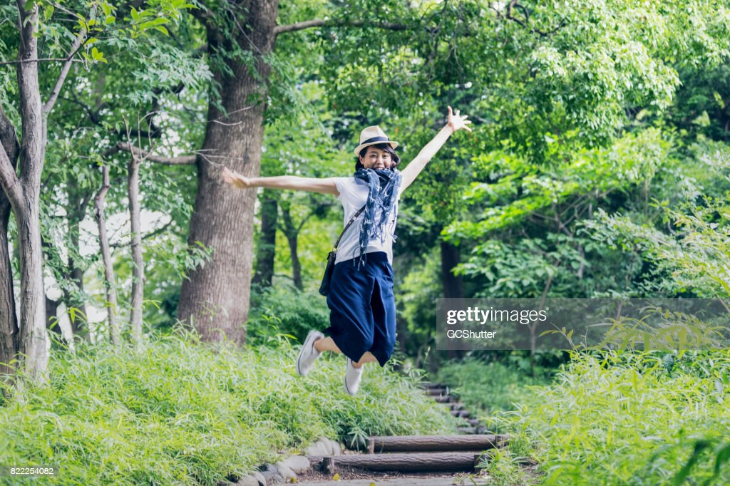 Jumping with joy after hearing good news : Stock Photo