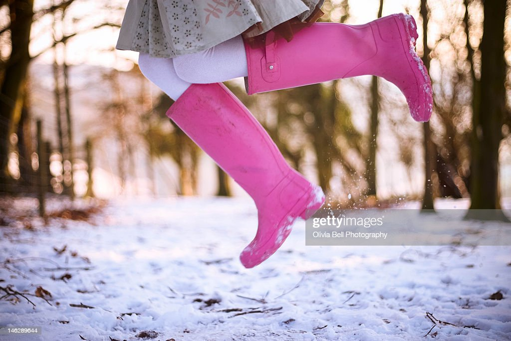 Jumping with pink boots : Stock Photo