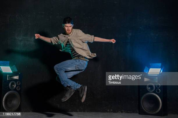 jumping young dancer in studio - one man only stock pictures, royalty-free photos & images