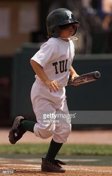 A Tulane bat girl runs back to the teams'' dugout with a bat during the Cal State Fullerton v Tulane game at the NCAA World Series game at Rosenblatt...
