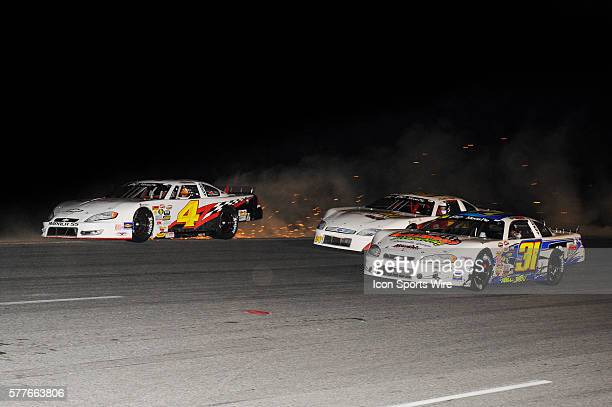 Michael Pilla Chevrolet Impala SS goes off track to make it three wide with Tyler Millwood Chevrolet Impala SS and Austin Hill Ford Fusion on the...