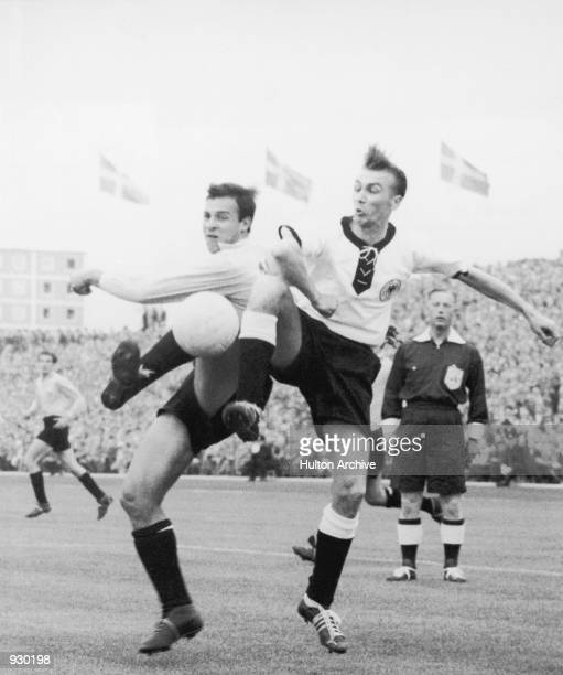 Referee Reg Leafe watches Georg Stollenwerk of West Germany tussle with Angel Labruna of Argentina during the FIFA World Cup Finals match played in...