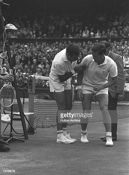 During his match with fellow Australian Owen Davidson Roy Emerson No1 seed slipped while rushing in to make a return and crashed into the umpire's...