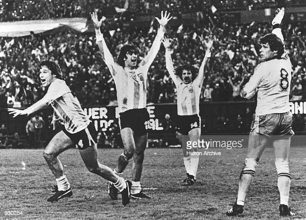 Argentina players celebrate as they score a goal during the FIFA World Cup Finals match against Hungary played at the Estadio Monumental in Buenos...