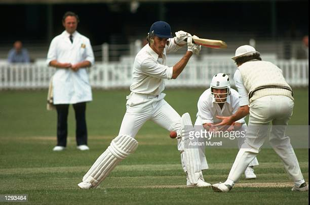 Chris TavarT of Kent bats while fielders Mike Gatting and John Emburey of Middlesex wait during a match at Lord's in London Mandatory Credit Adrian...