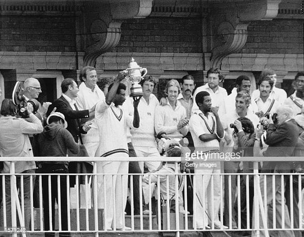 Clive Lloyd of the West Indies holds up the magnificent World Cup Trophy after beating England by 92 runs at Lords Cricket Ground in London England...