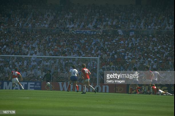 Bryan Robson of England scores the first goal for England and the fastest ever goal in World Cup football during the World Cup first round match...