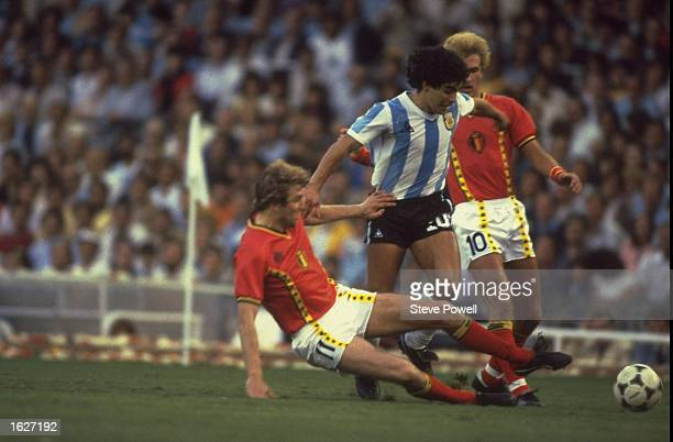 Diego Maradona of Argentina is tackled during the World Cup match against Belgium in Barcelona Spain Belgium won the match 10 Mandatory Credit Steve...
