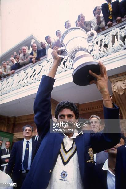 Kapil Dev of India lifts the Cricket World Cup after his team beat the West Indies at Lords in the final.