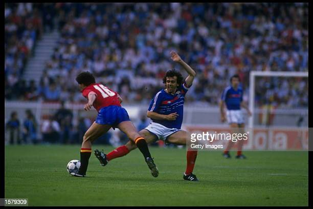 Michel Platini of France challenges for the ball during the final of the European nations cup in Paris, France. France went on to win the match by...