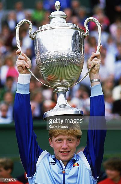 Boris Becker of Germany poses with the winning trophy after winning the Stella Artois Championships held at the Queens Club in London Mandatory...