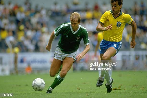 Colin Clarke of Northern Ireland takes on Edhino Ibra of Brazil during the World Cup match at the Jalisco Stadium in Guadalajara Mexico Brazil won...