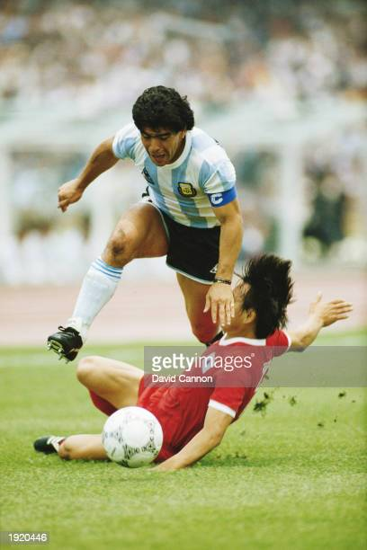 Diego Maradona of Argentina rides a tackle during the World Cup First Round match against South Korea at the Olympic Stadium in Mexico City Argentina...
