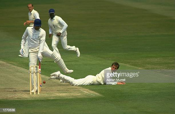 John Emburey of England attempts to run out Ravishankar Shastri of India during the Second Test match at Headingley in Leeds, England. India won the...