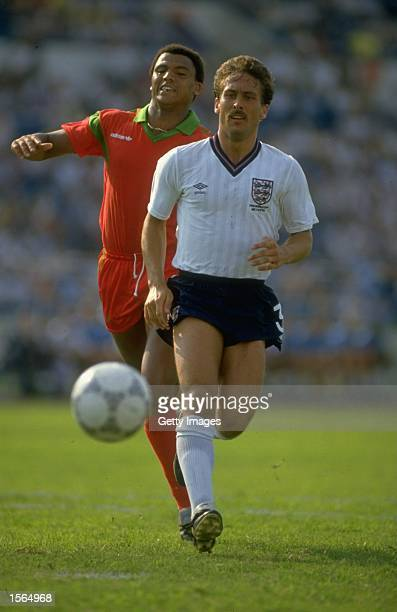 Kenny Sansom of England is chased by a Moroccan defender during the World Cup Group F match at the Estadio Tecnologico in Monterrey, Mexico. The...